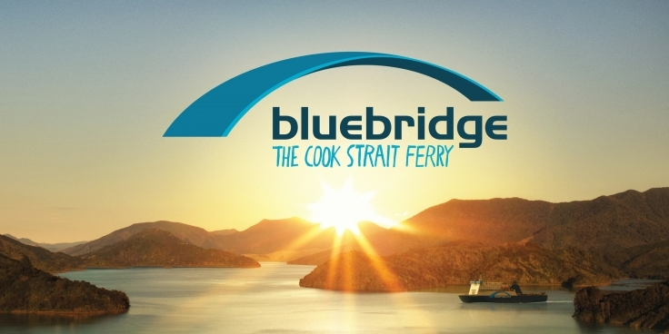 Bluebridge ferry passing through the Marlborough Sounds at sunrise with the company logo superimposed