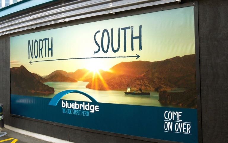 A billboard featuring the North-South marketing message